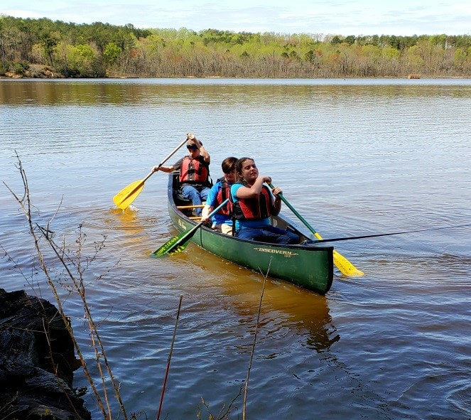 MMS student in a canoe at Menokin.