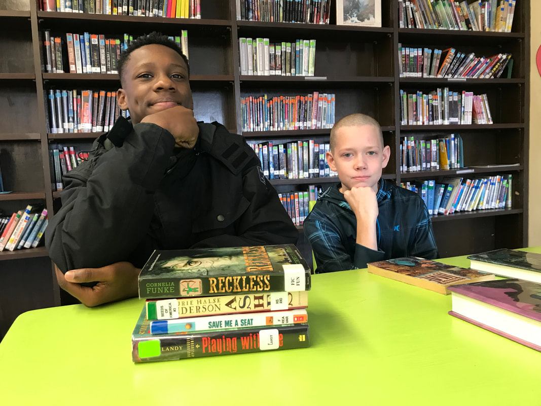 Mr. Spears and Mrs. Weldon's classes worked with librarian, Mrs. Stiefvater, to challenge students to create Spine Poetry.  Books were selected and arranged thoughtfully to produce some interesting poems.