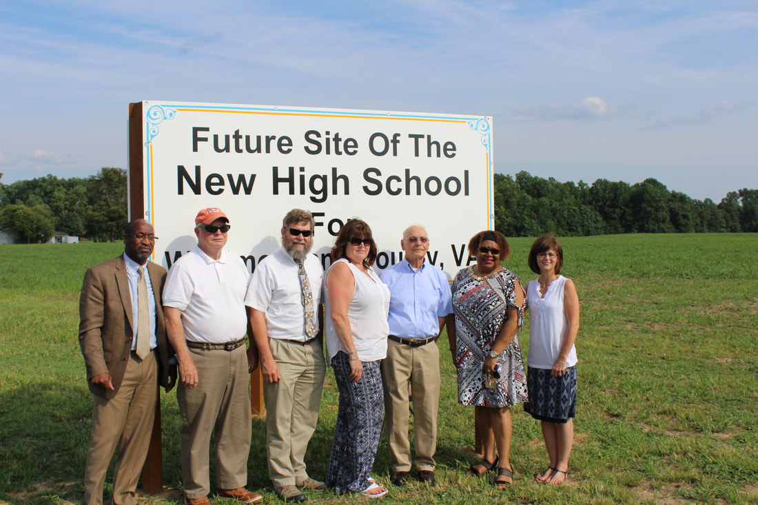 Westmoreland School Board, Russ Culver, and Dr. Perry pose with the sign.