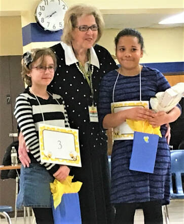 Spelling Bee winner and runner up with Mrs. Glancy